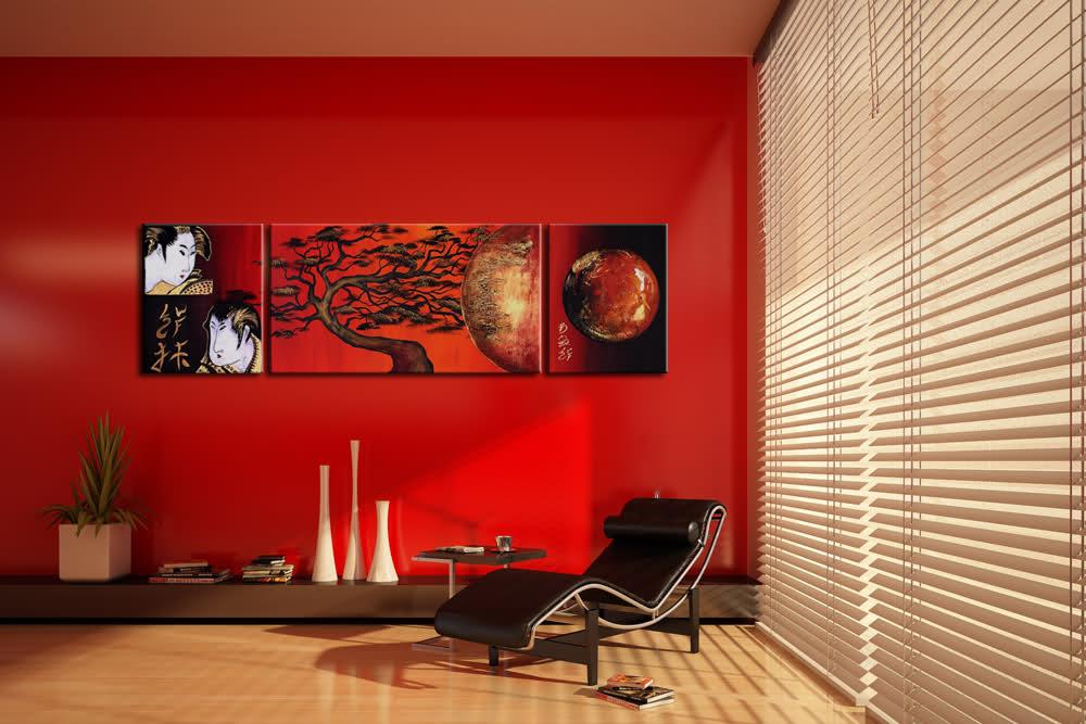 salotto rosso con fotoquadri